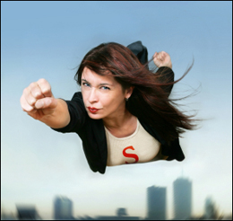 """alt=""""Hopeful woman flying as Superwoman, in business suit"""""""