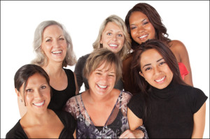 """alt=""""Group of 6 Women of diverse ages and ethnicity, smiling and standing close together"""""""