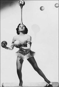 "alt=""Vintage photo of circus woman juggling many balls"""
